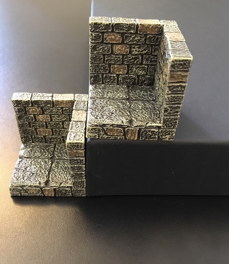 A Dwarvenforge wall+floor corner piece sits beside a GRÅSIDAN paper tray turned upside down. They are the same height.